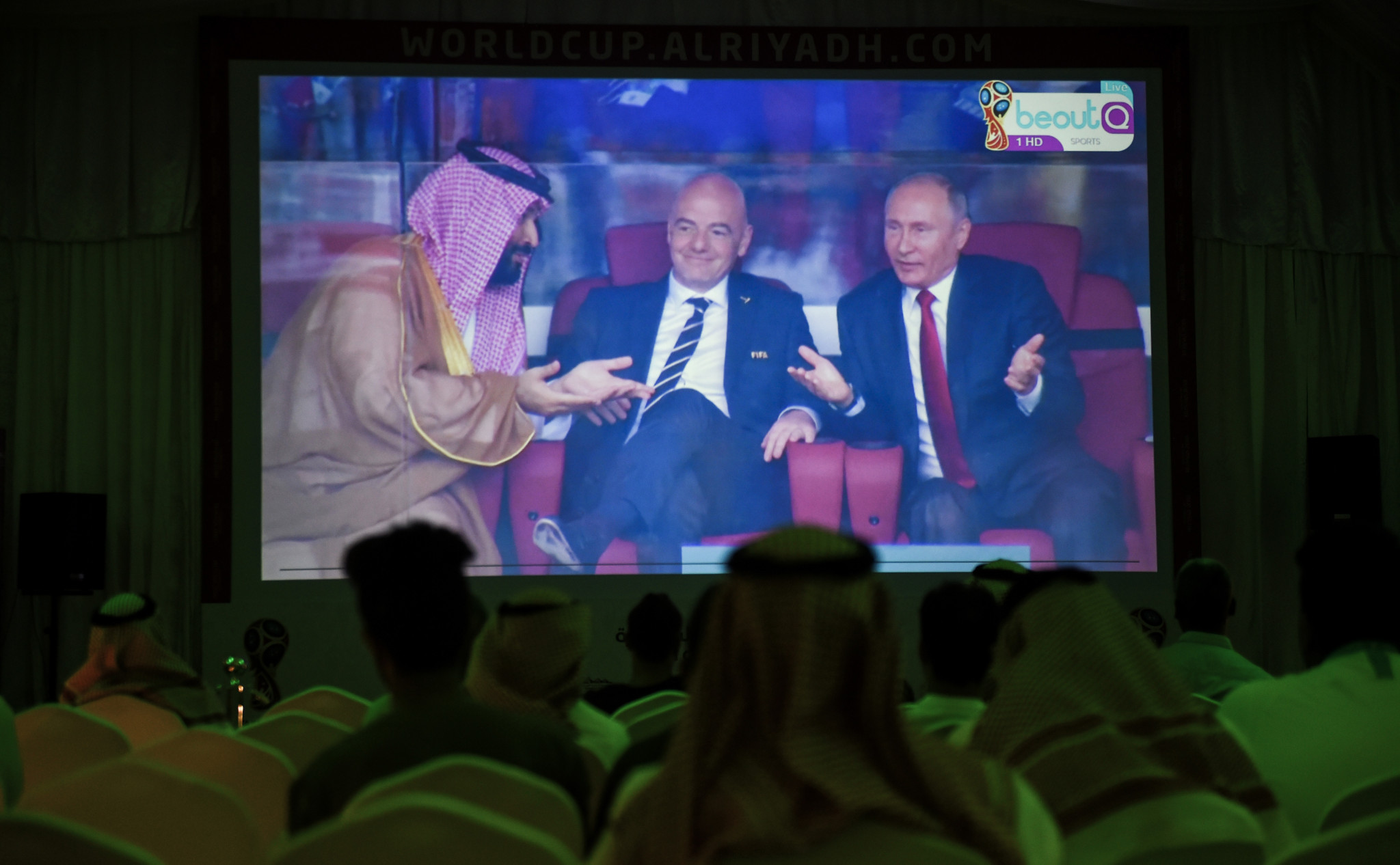 Fans in Riyadh watch their country's opening World Cup match against on Russia on the BeoutQ feed as Saudi Crown Prince Mohammed bin Salman, left, attends the game in Moscow ©Getty Images