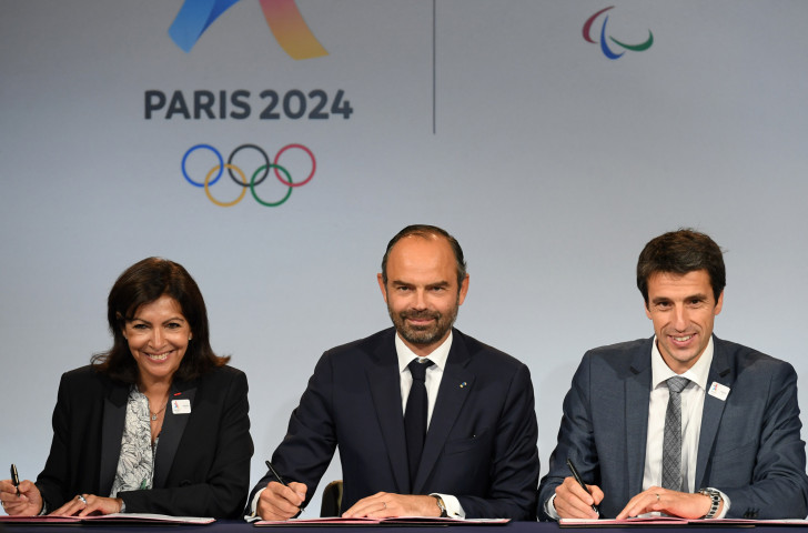 Anne Hidalgo - Paris Mayor and President of the SOLIDEO Games delivery body - Prime Minister Edouard Philippe and Tony Estanguet, Paris 2024 President, display a clear unity of purpose as they complete the signing of the Games protocol in the French capital ©Paris 2024
