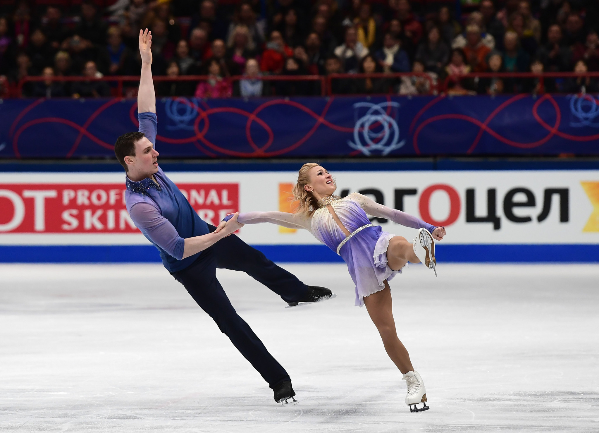 Germany's Aliona Savchenko and Bruno Massott won gold in the pairs event, despite Huang Feng