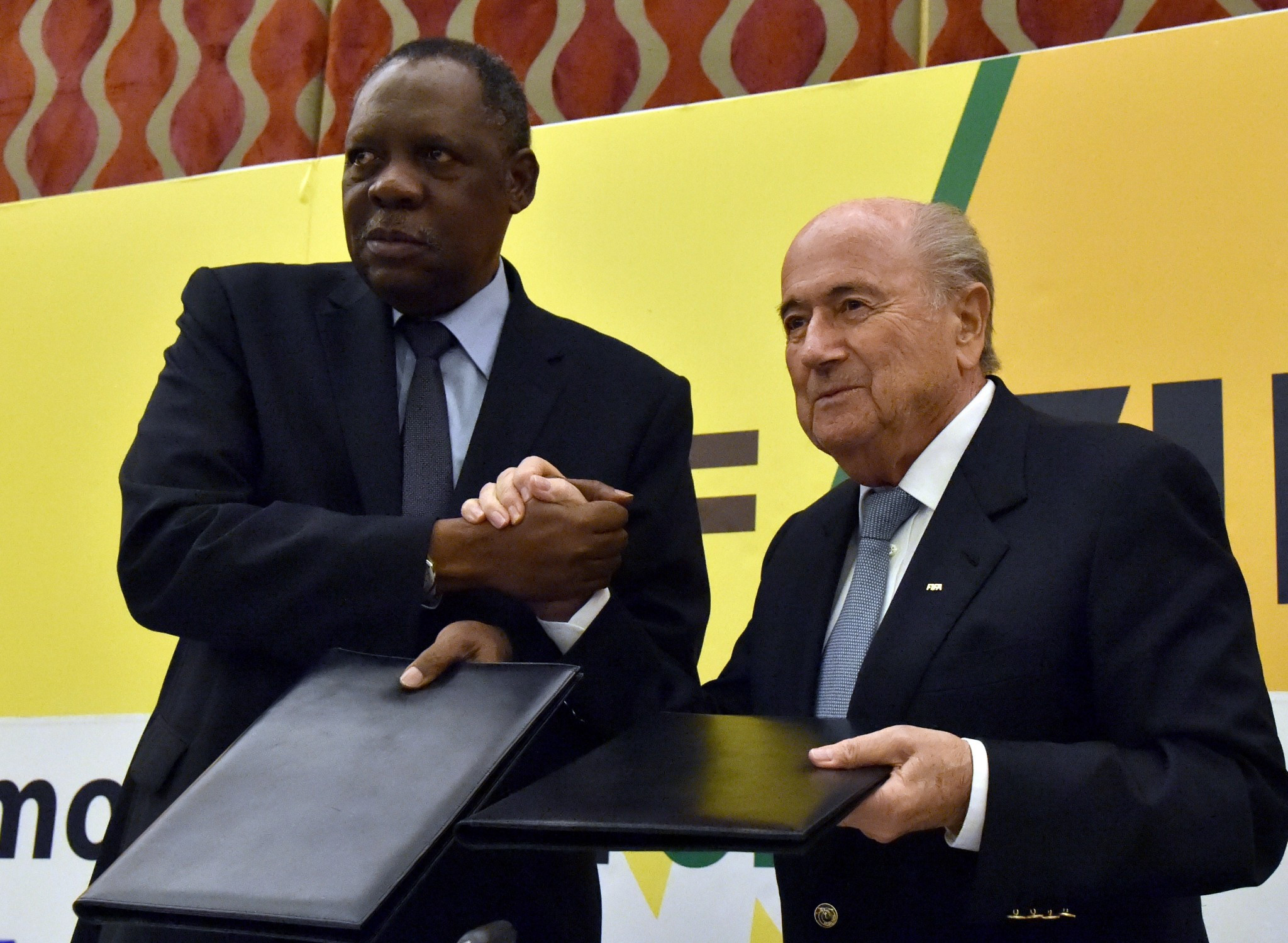 Issa Hayatou, (pictured, left, with Sepp Blatter) has become interim President of FIFA ©Getty Images