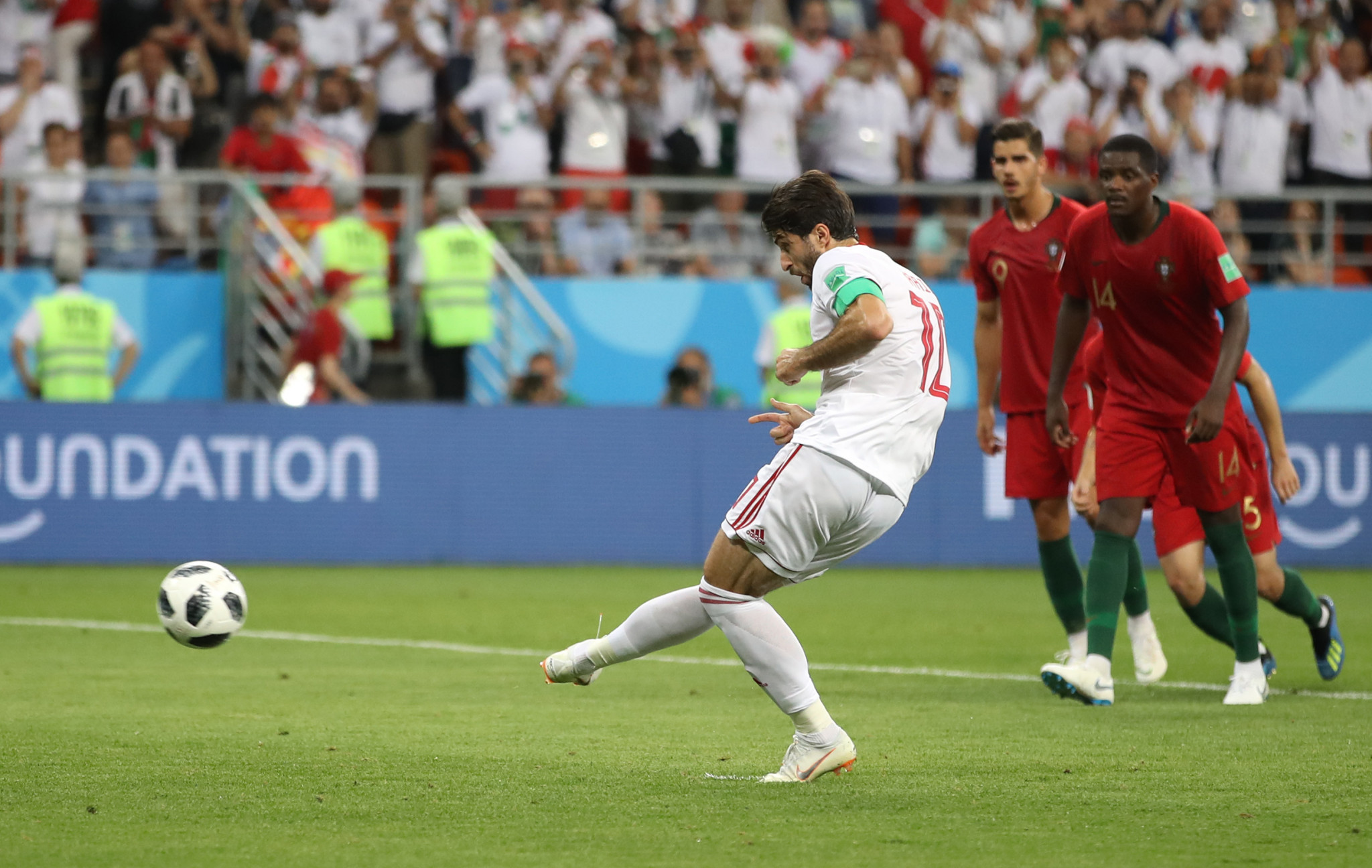 Karim Ansarifard's spot-kick three minutes into stoppage time earned Iran a point and condemned Portugal to second place in a controversial end to Group B ©Getty Images