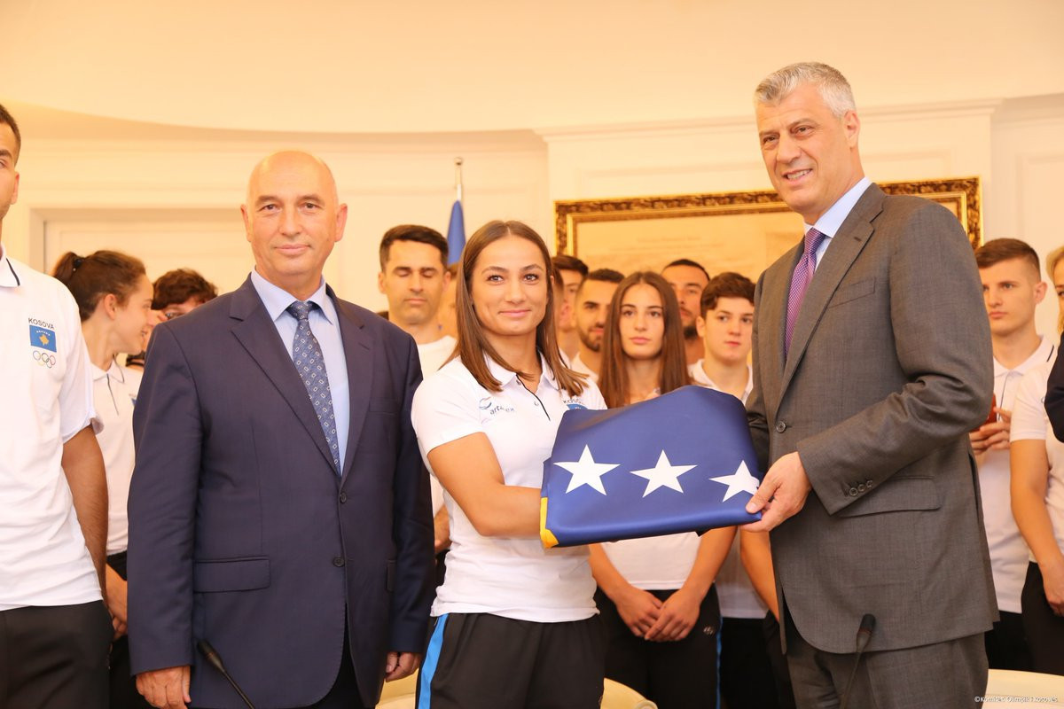 Olympic judo champion Majlinda Kelmendi received Kosovo's flag on behalf of the team before they travelled to the Mediterranean Games and is working at Tarragona 2018 as a coach ©Twitter