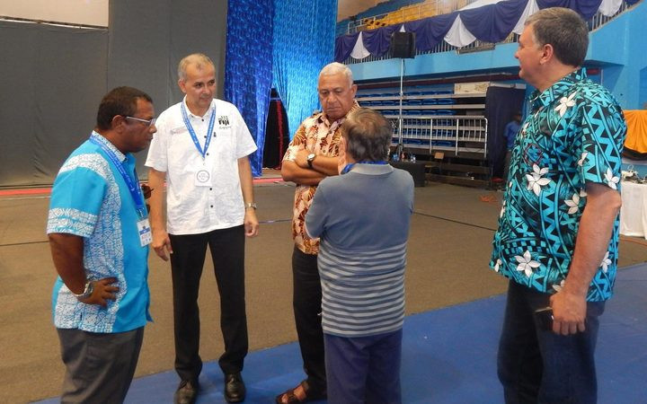 Weightlifting Fiji President Atma Maharaj, second left, admitted the mistake ©Facebook