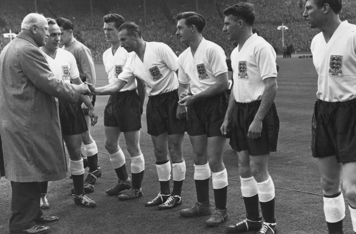Sir Stanley Matthews, pictured shaking hands with Lord Roseberry before England's match against Scotland in 1957, learned a hard lesson playing in one of his early international matches against Germany ©Getty Images