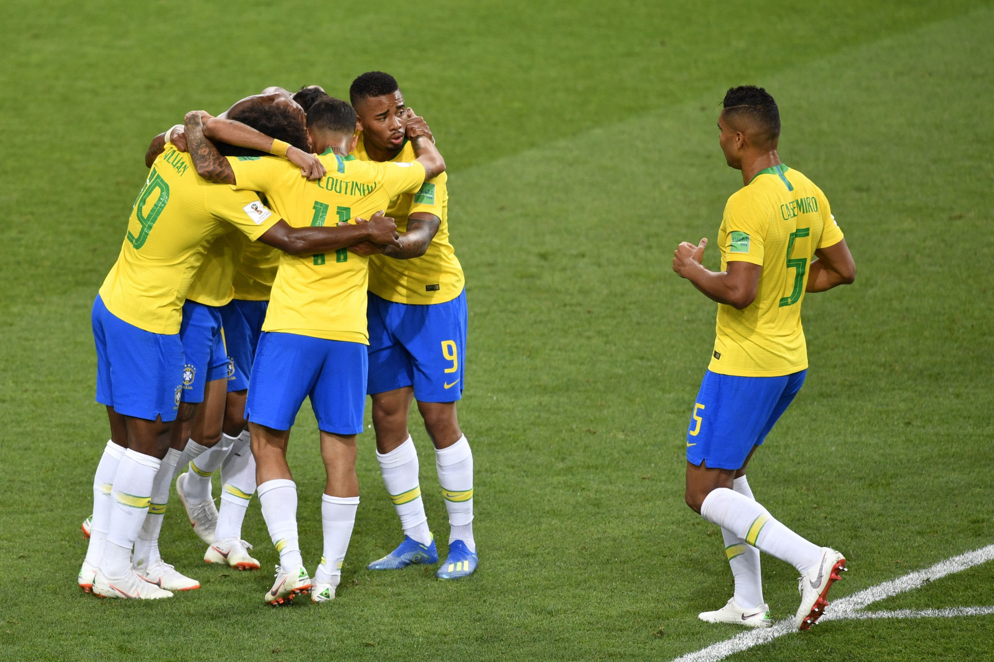 Brazil players celebrate during their 2-0 win over Serbia ©Getty Images