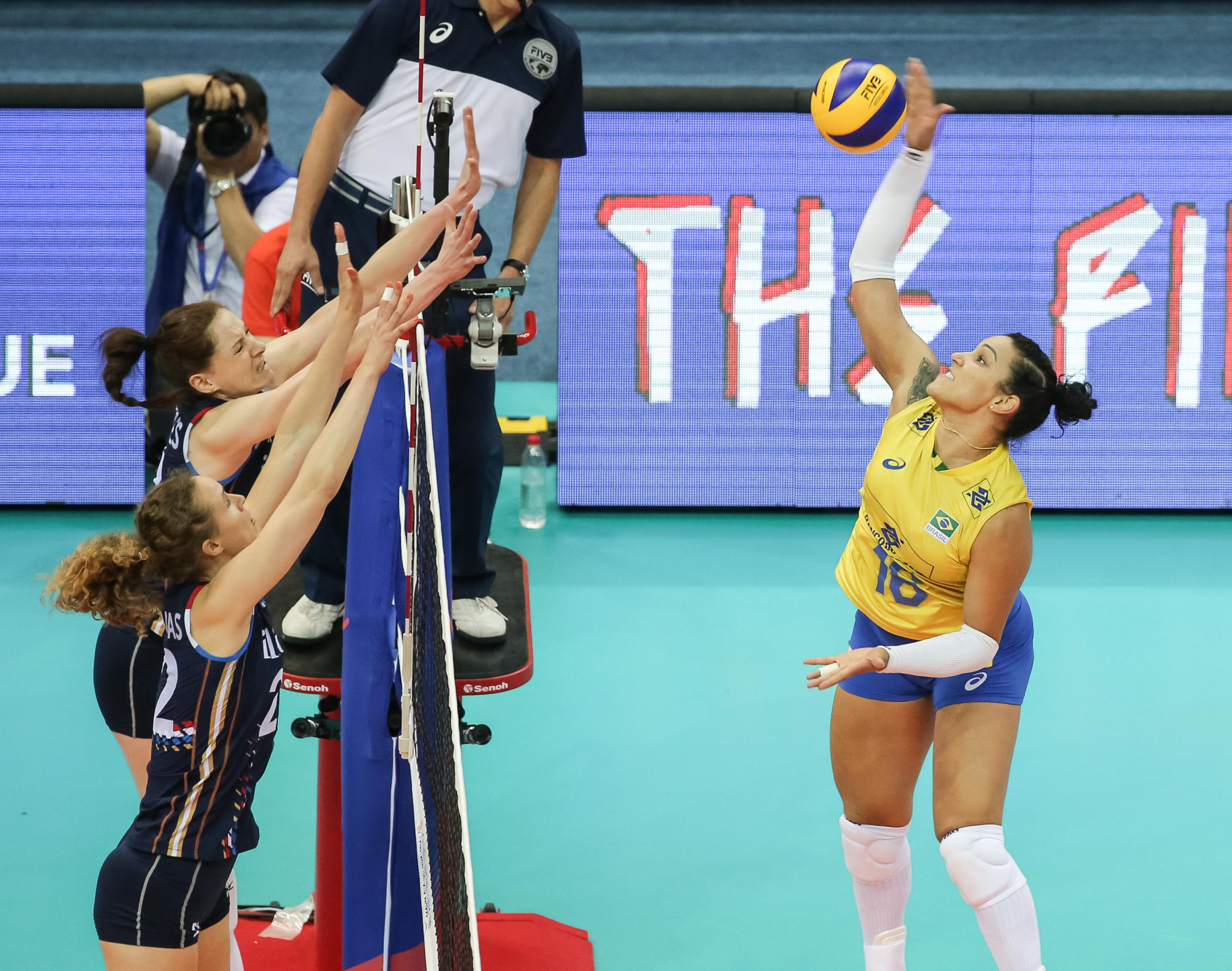 Brazil have also reached the last four with a 100 per cent record ©FIVB