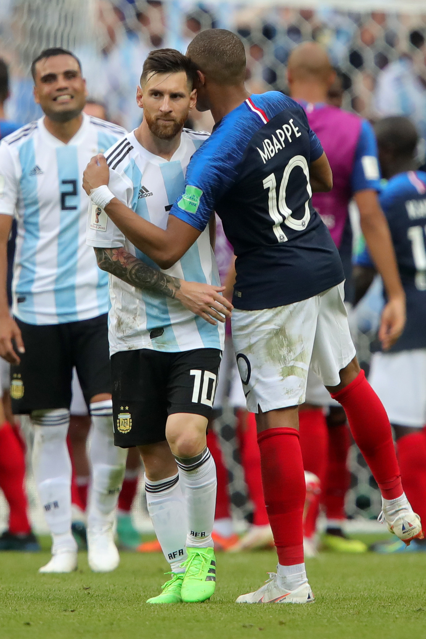 Lionel Messi, left, is commiserated by Kylian Mbappe after a possible changing of the guard ©Getty Images