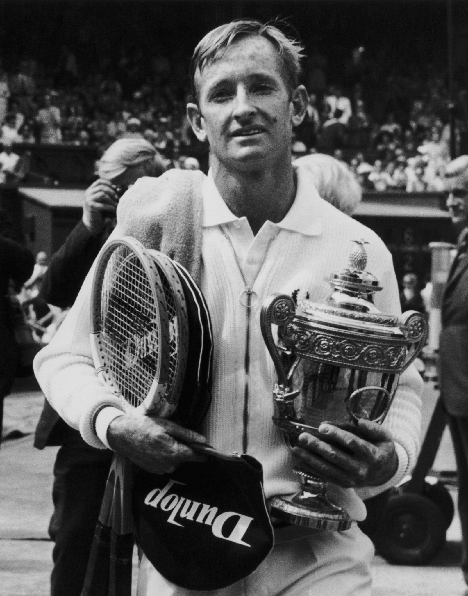 Rod Laver pictured with the men's trophy after the first Wimbledon final of the open era in 1968, and six years after winning his first title there ©Getty Images