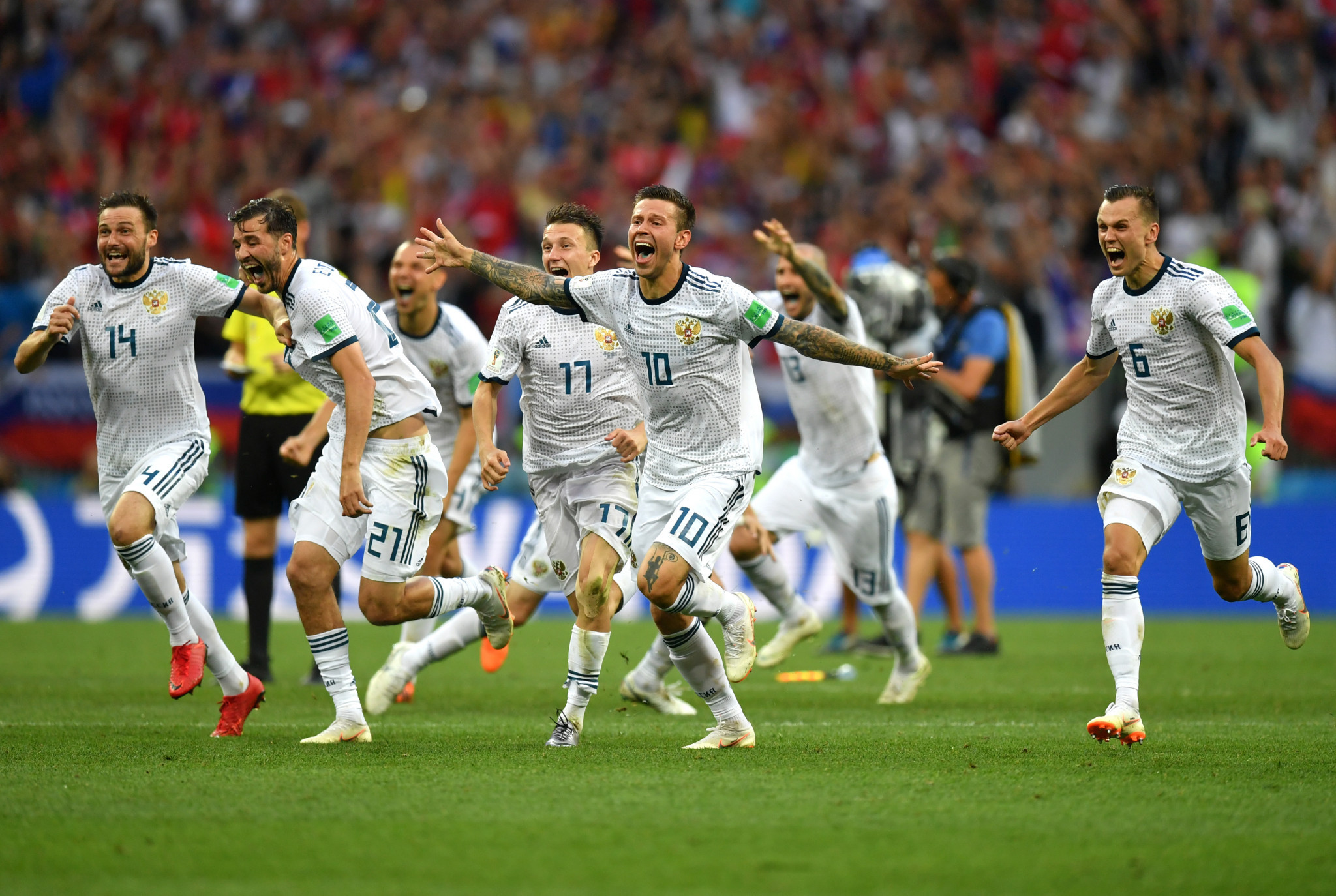 Russia celebrate after beating Spain on penalties ©Getty Images