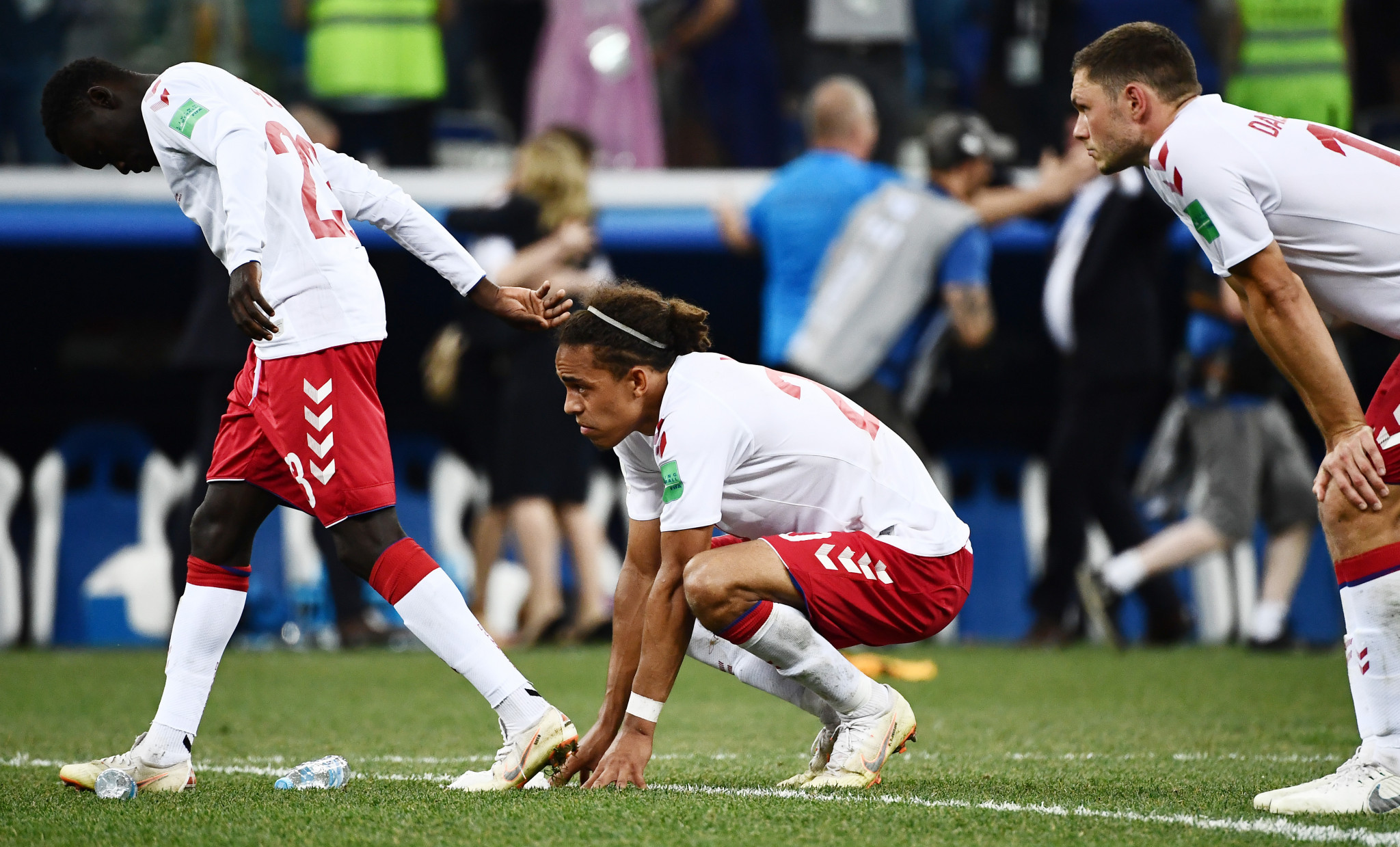 Denmark sink to the ground after their agonising defeat ©Getty Images
