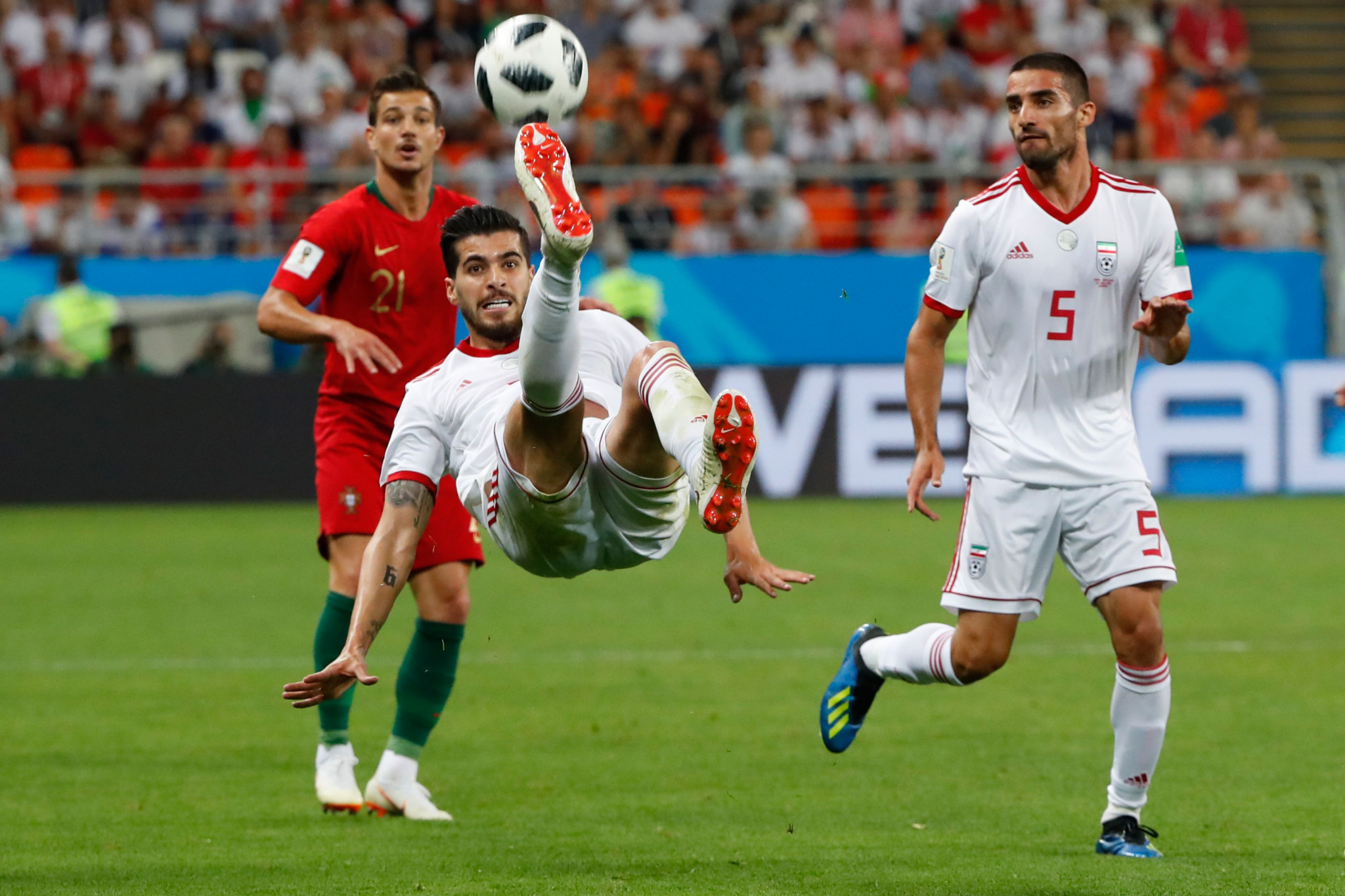 Saeid Ezatolahi makes a clearance during the FIFA World Cup match between Iran and Portugal ©Getty Images