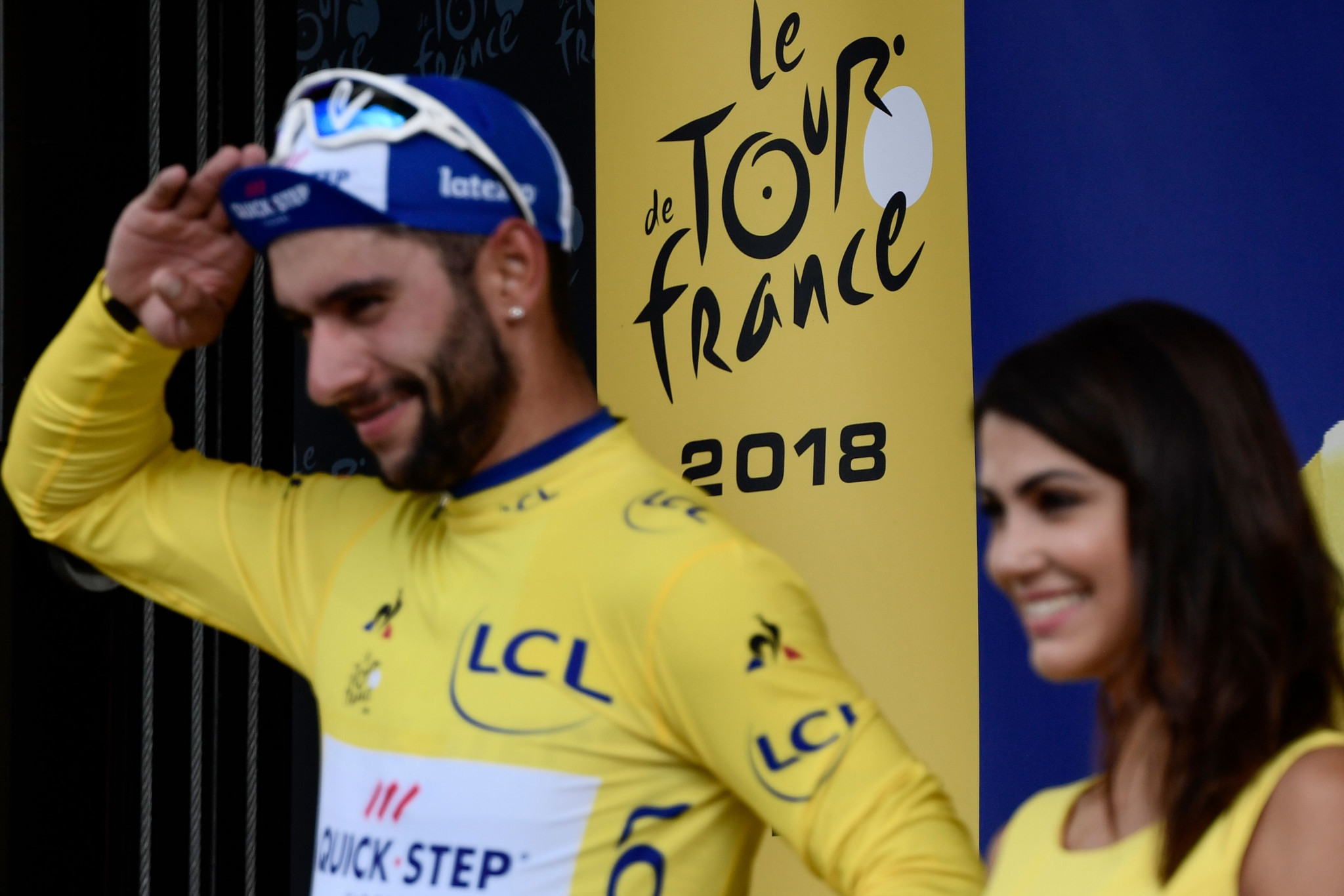 Gaviria takes Tour de France yellow jersey on debut as favourites suffer in dramatic final kilometres