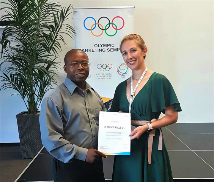 Bahamas Olympic Committee vice-president Clarence Rolle received a certificate from Natascha Trittis, marketing training manager of the IOC's Television and Marketing Services unit, after the Olympic Marketing Seminar ©BOC