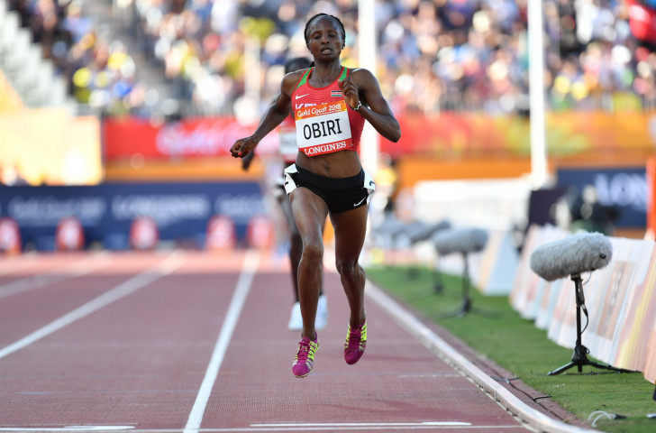Kenya's Hellen Obiri, pictured winning the Commonwealth 5,000m title earlier this year at the Gold Coast Games, faces Ethiopia's world 1,500m record holder Genzebe Dibaba over the longer distance in tomorrow's IAAF Diamond League meeting in Rabat ©Getty Images