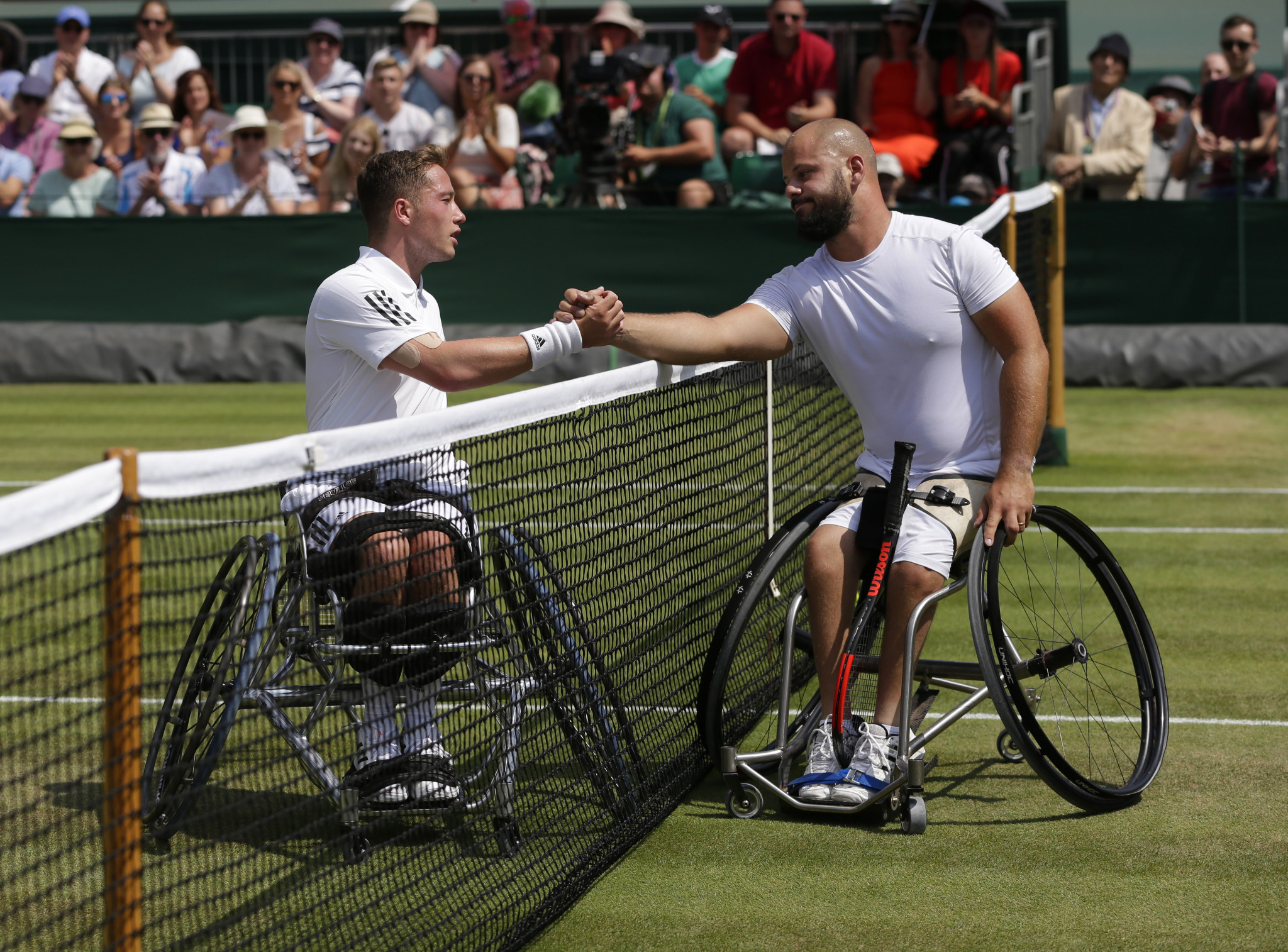 Britain's Alfie Hewitt, left, and defending champion Peter Olsson shake hands after their wheelchair men's singles semi-final at Wimbledon ©Getty Images