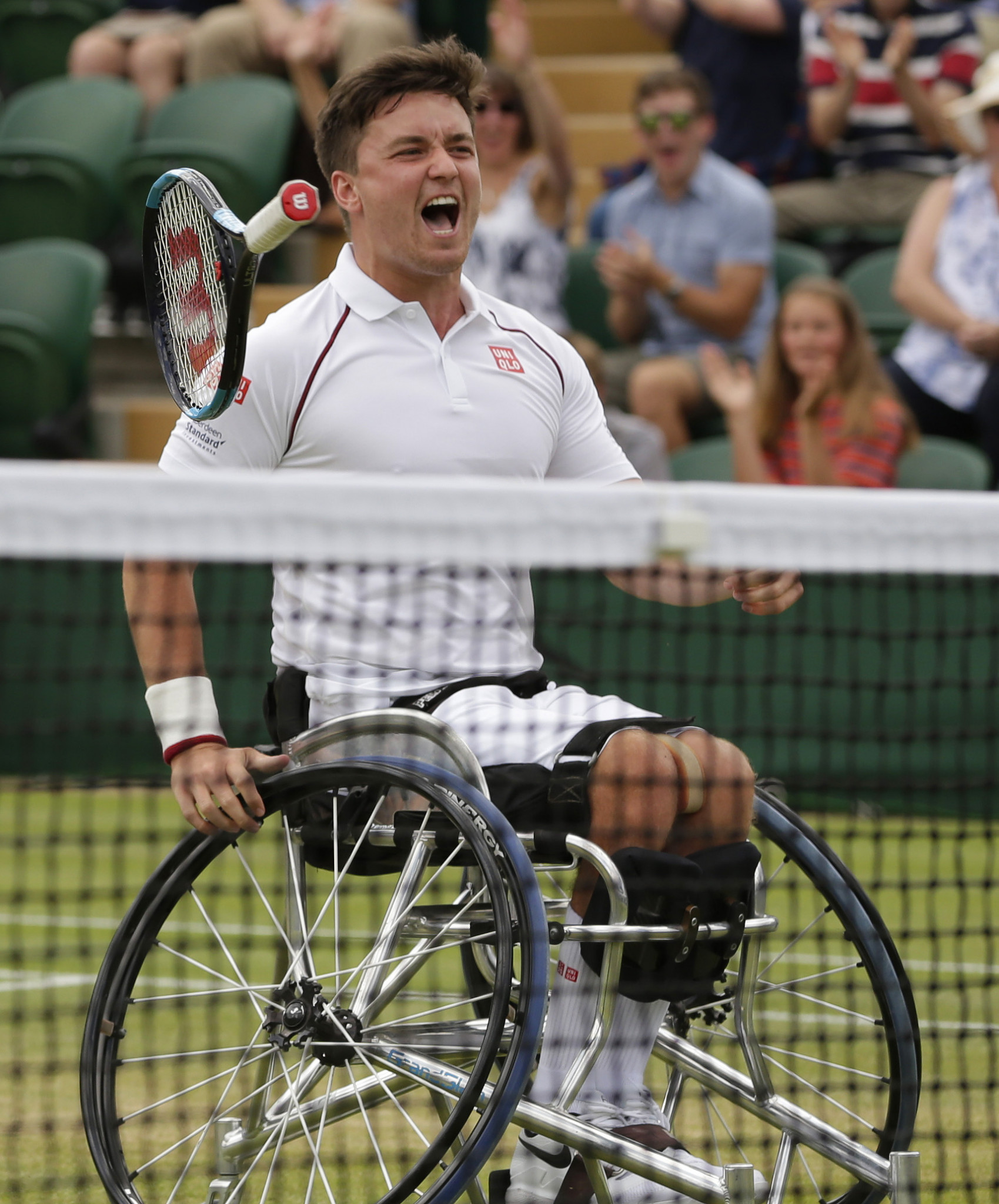 Britain's Gordon Reid celebrates exuberantly as he and Alfie Hewett secure their third successive Wimbledon men's doubles wheelchair title ©Getty Images