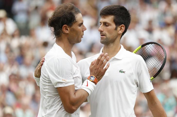 Rafa Nadal, left, congratulates Novak Djokovic after their epic Wimbledon men's singles semi-final ©Getty Images