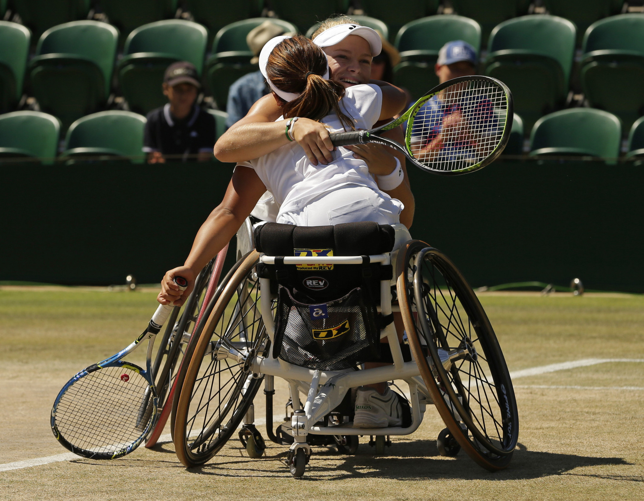 Wimbledon wheelchair singles champion Diede de Groot of The Netherlands celebrates with her partner Yui Kamiji of Japan after they won the women's doubles title ©Getty Images