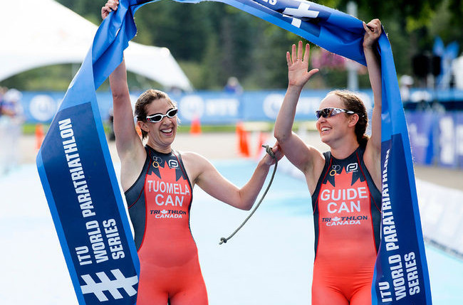 Canada's Jessica Tuomela and her guide Lauren Babineau celebrate victory in the women's visually impaired race at the ITU Para-triathlon World Cup in Magog, Quebec ©ITU