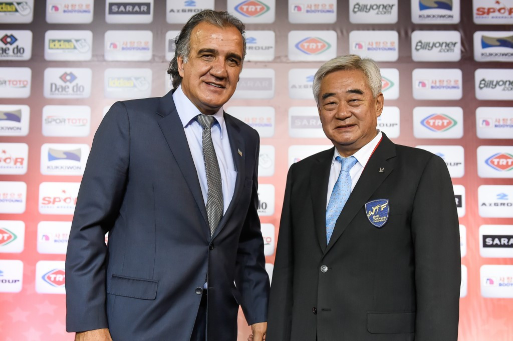 Amaury Russo, pictured left with World Taekwondo Federation President Chungwon Choue, said the points being raised at the General Assembly are important ©WTF