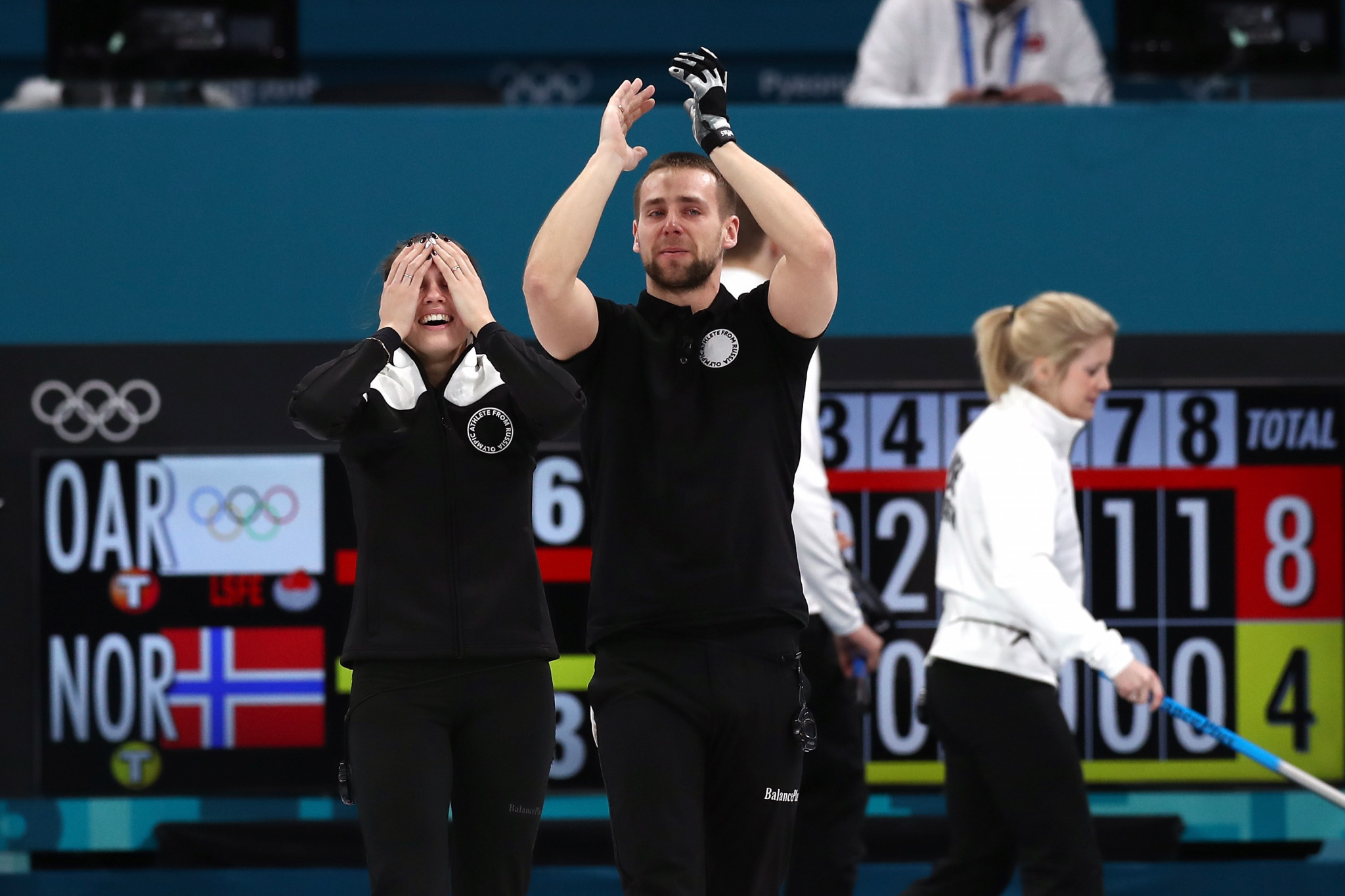 Aleksandr Krushelnitckii and wife Anastasia Bryzgalova were stripped of their Olympic mixed doubles curling bronze medals ©Getty Images