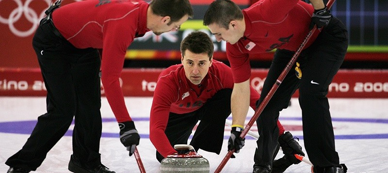 Pete Fenson, centre, was the skip when the United States won its first-ever Olympic curling medal - a bronze at Turin 2006 ©Getty Images
