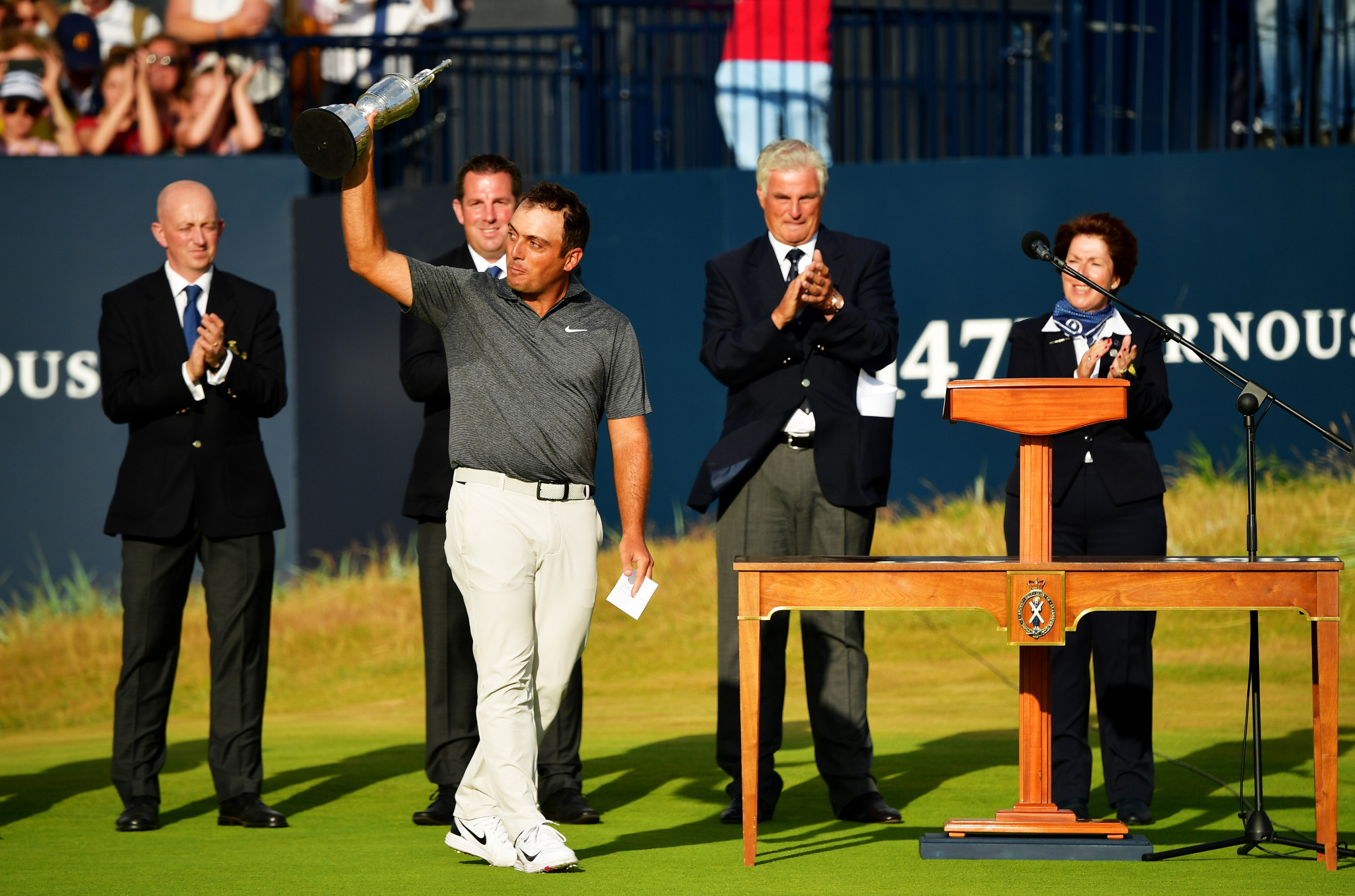 Molinari claims first major championship after emerging from pack to win The Open