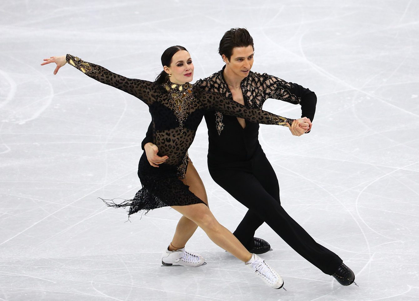 Tessa Virtue and Scott Moir won one of their two golds at the 2018 Winter Olympics in the ice dance category ©COC