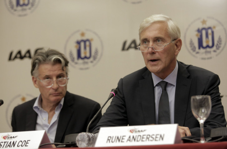 IAAF President Sebastian Coe looks on as IAAF Taskforce head Rune Andersen speaks on the subject of Russia after the IAAF Council meeting in Buenos Aires ©Getty Images