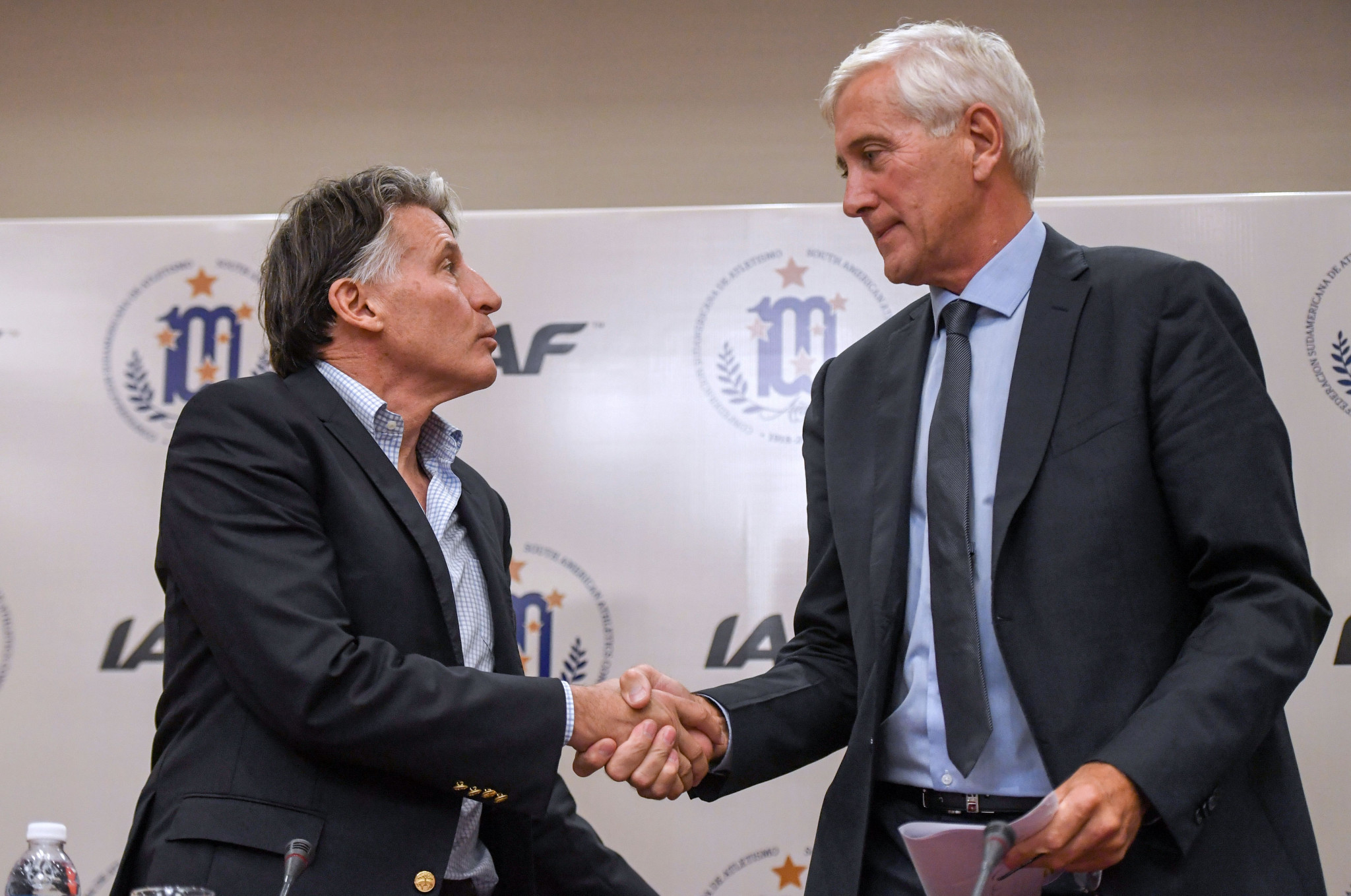 Sebastian Coe and Rune Andersen shake hands following the IAAF Council meeting in Buenos Aires today ©Getty Images