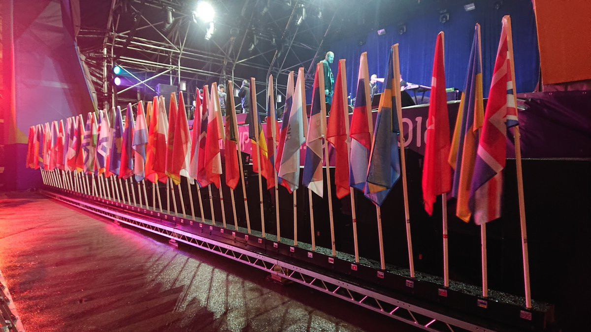 Flags of the competing nations were paraded at the welcome event ©Glasgow 2018
