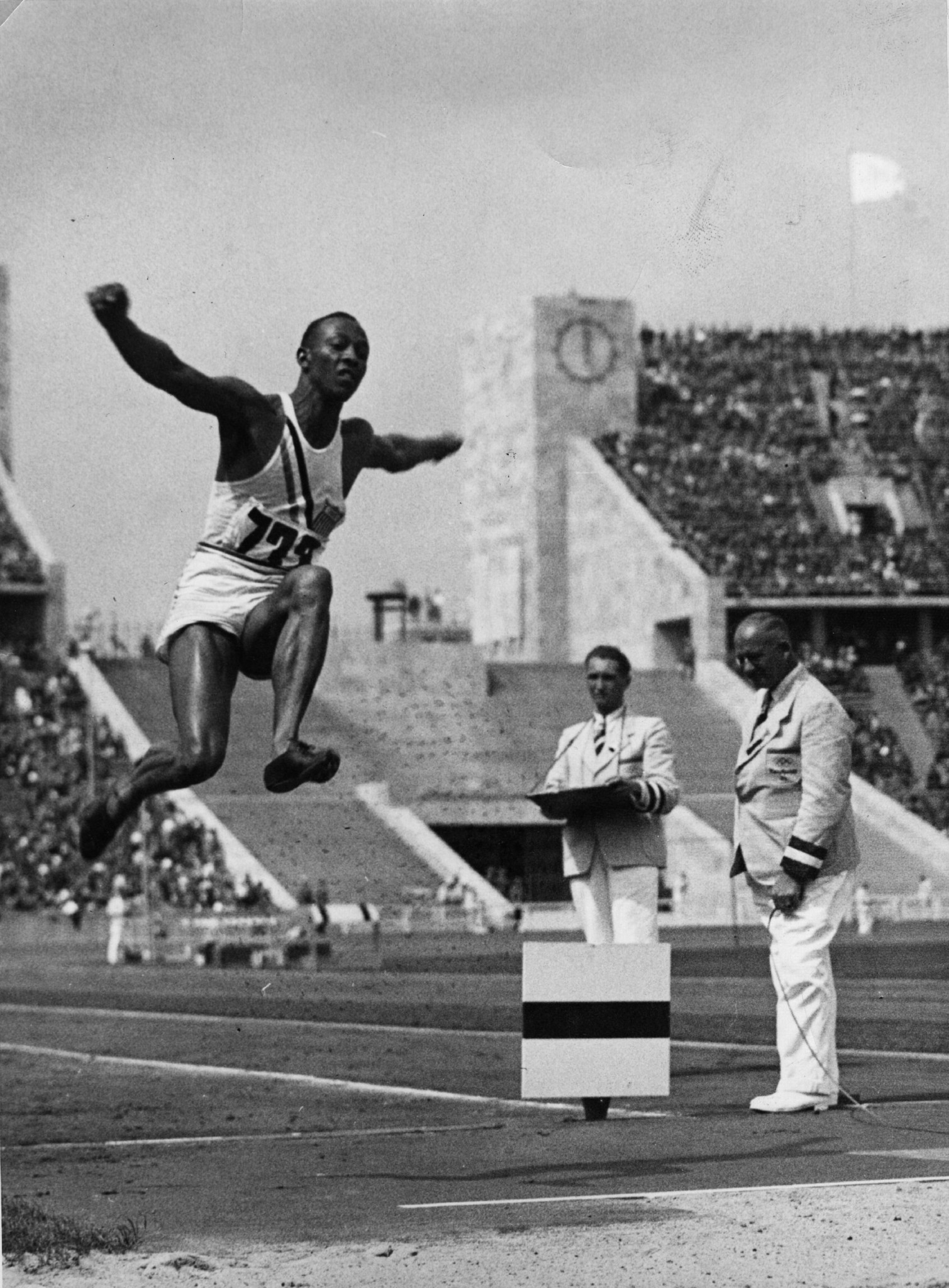 Jesse Owens pictured in the long jump at the 1936 Berlin Olympics - a year earlier in Ann Arbor he had time for only one effort, and became the first man to better eight metres, his world record of 8.13m lasting until 1960 ©Getty Images