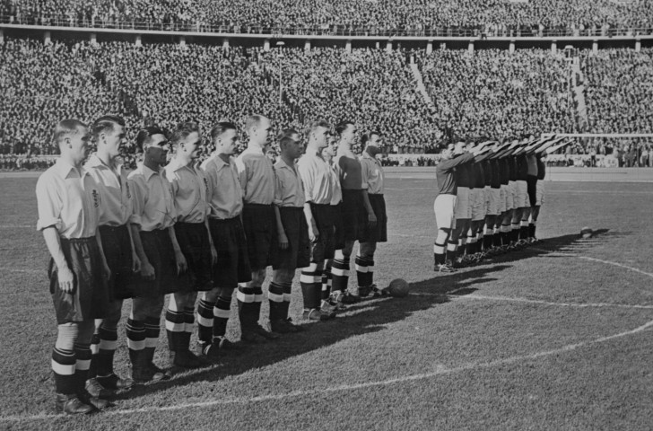 England's football players will shortly follow the German lead of a Nazi salute before their 1938 match at Berlin's Olympic Stadium ©Getty Images
