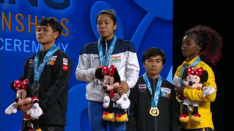 India's Mirabai Chanu, centre, hopes to recover from injury in time to compete in Ashgabat in November and defend the IWF World Championships title she won in Anaheim last year ©YouTube