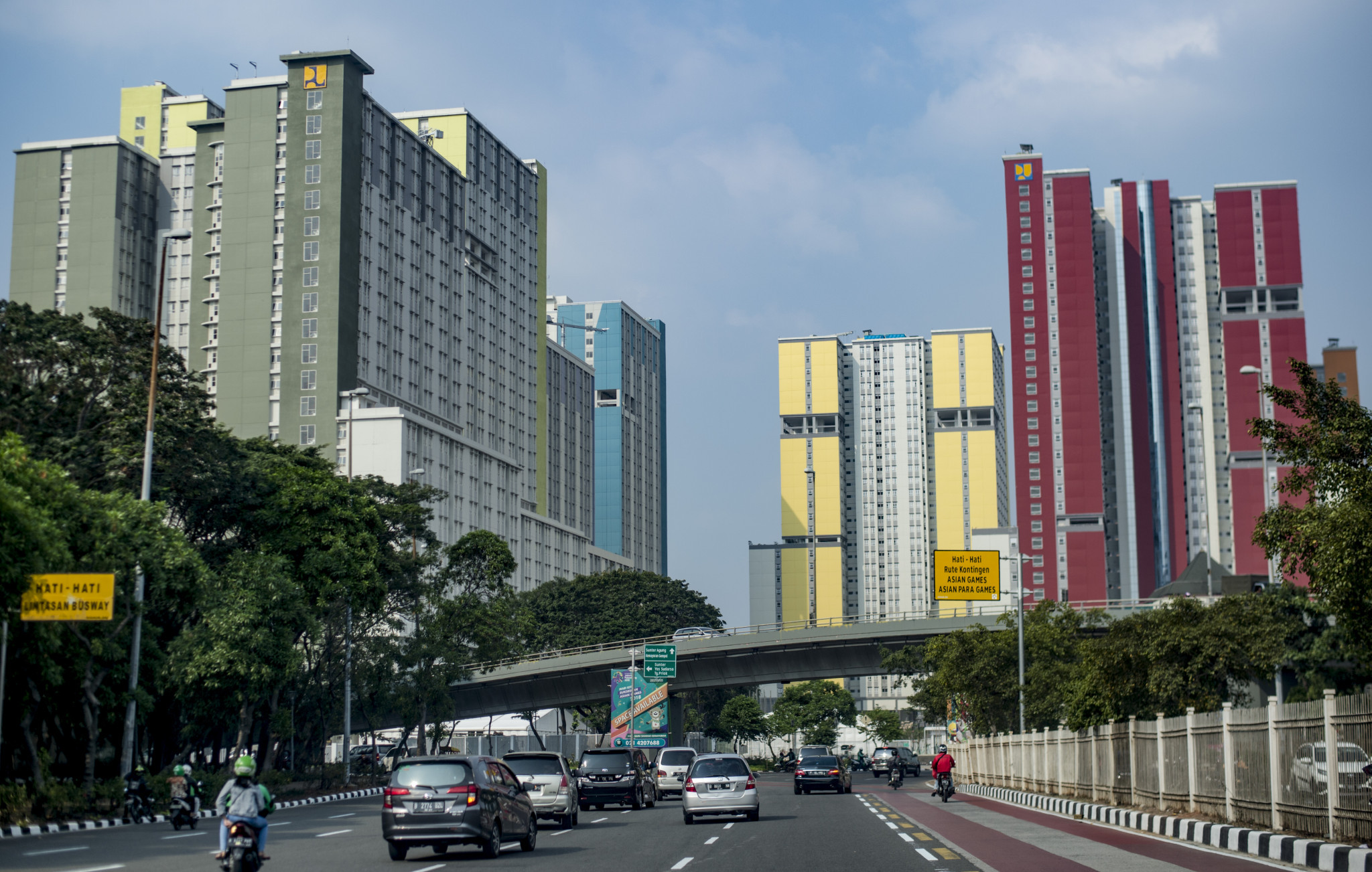 Traffic commutes next to the newly-completed Asian Games Athletes' Village in Kemayoran district, central Jakarta - it is hoped closing schools during the event will help reduce congestion ©Getty Images