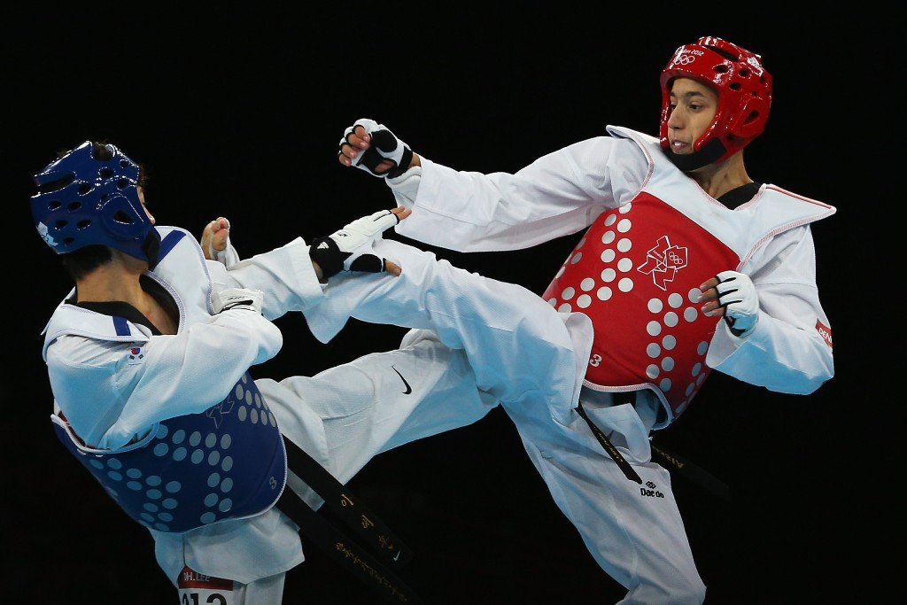Daehoon Lee of Korea competes against Alexey Denisenko of Russia during the London 2012 Olympic Games ©Getty Images