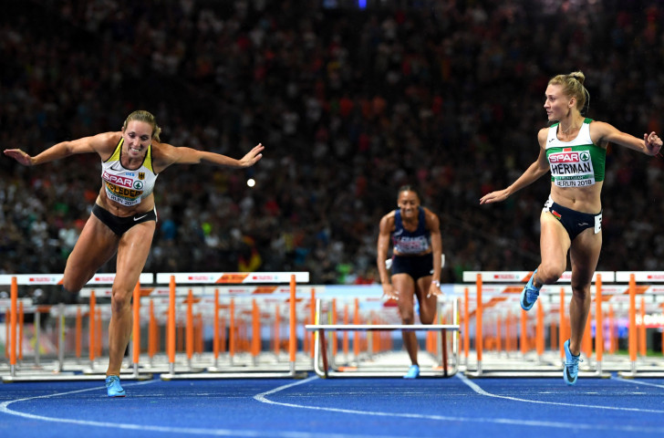 Elvira Herman of Belarus, right, wins the European title in the 100m hurdles ©Getty Images