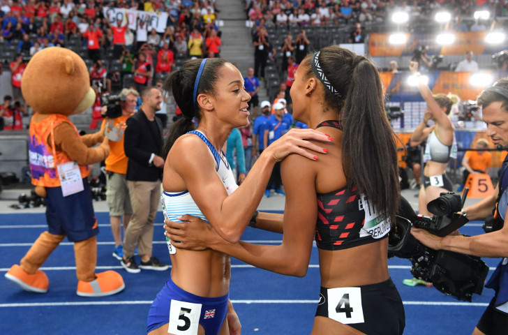 Britain's heptathlon silver medallist Katerina Johnson-Thompson, left, and Belgium's winner Nafissatou Thiam in the afermath of a titanic heptathlon competition in Berlin ©Getty Images