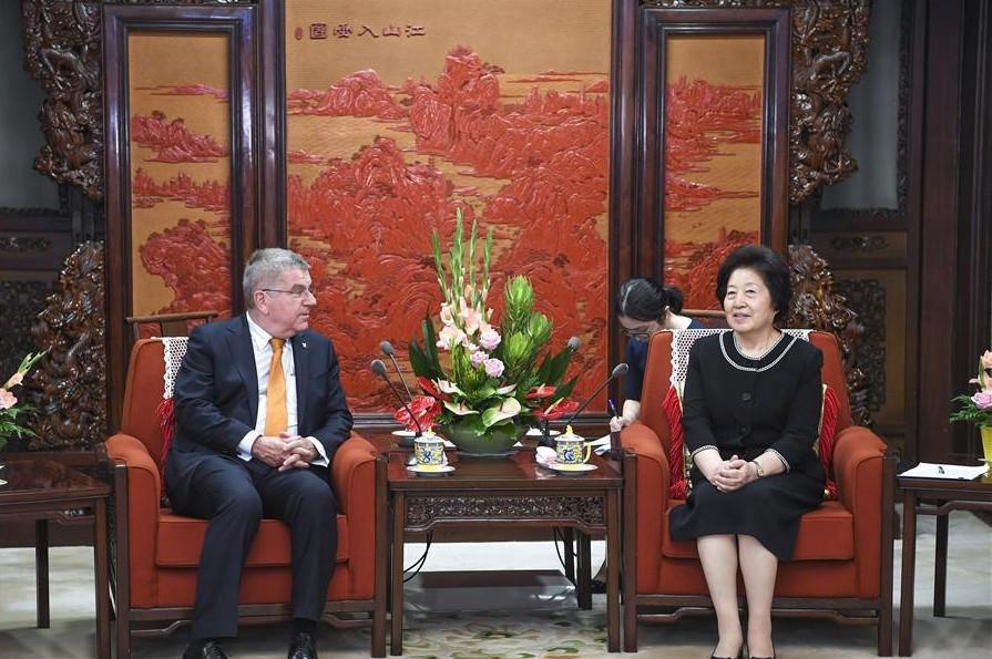 Sun Chunlan met IOC President Thomas Bach in June ©COC