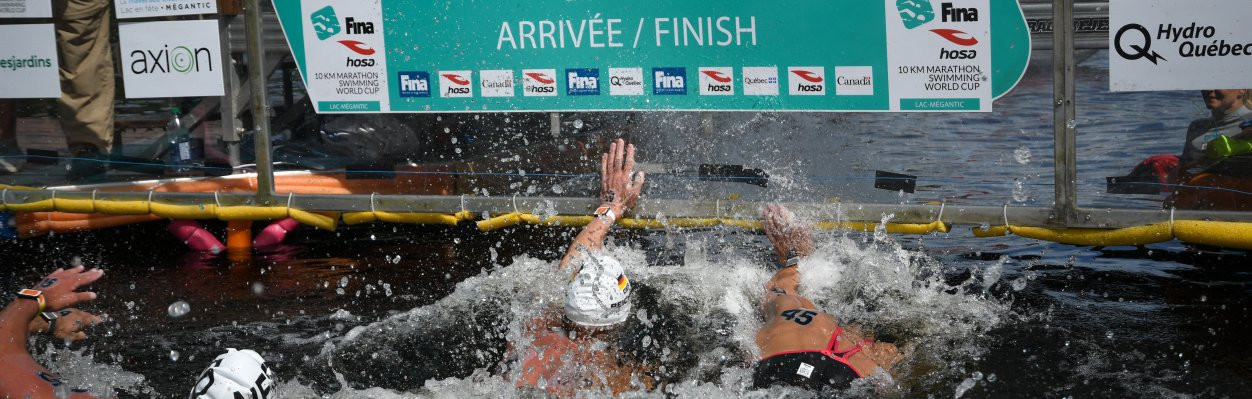 For the second race in a row a video replay was needed to decide the men's race on the FINA Marathon Swim World Series at Lac Megantic in Canada©FINA
