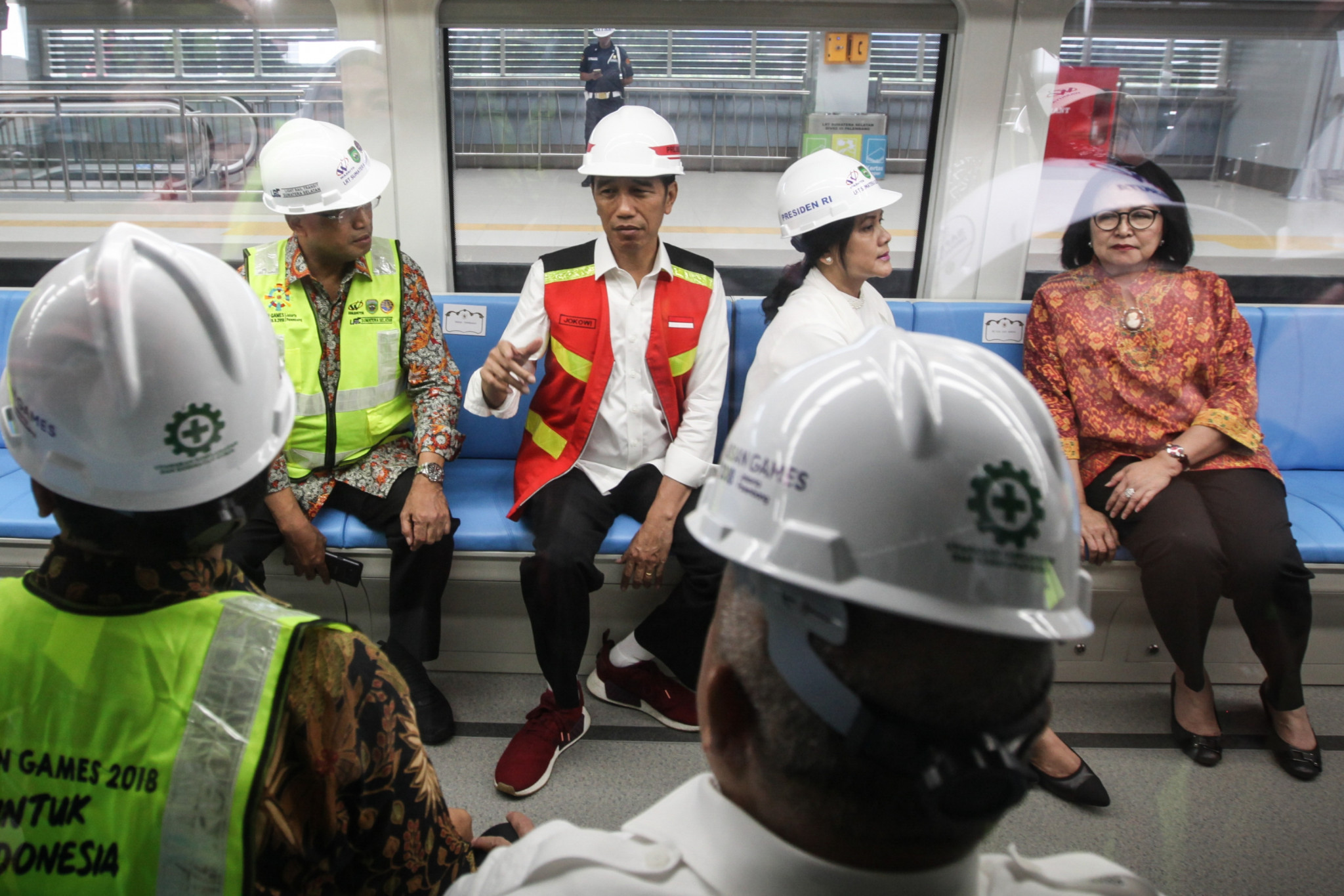 Indonesia's President Joko Widodo, second from left, sits inside a LRT rail car at Jakabaring station in Palembang ©Getty Images