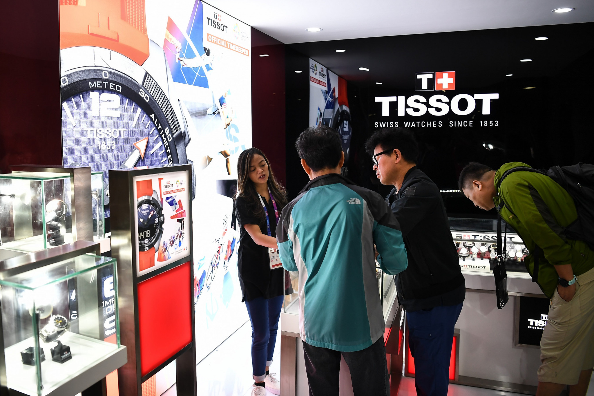 Journalists take the opportunity to view a booth dedicated to Tissot, the official timekeeper of the Games, in the Main Press Centre ©Getty Images
