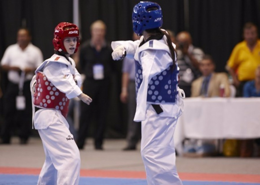 Ukraine's Viktoria Marchuk, in the red uniform, won her third consecutive World Para-Taekwondo Championships title at Moscow in 2014 ©WTF