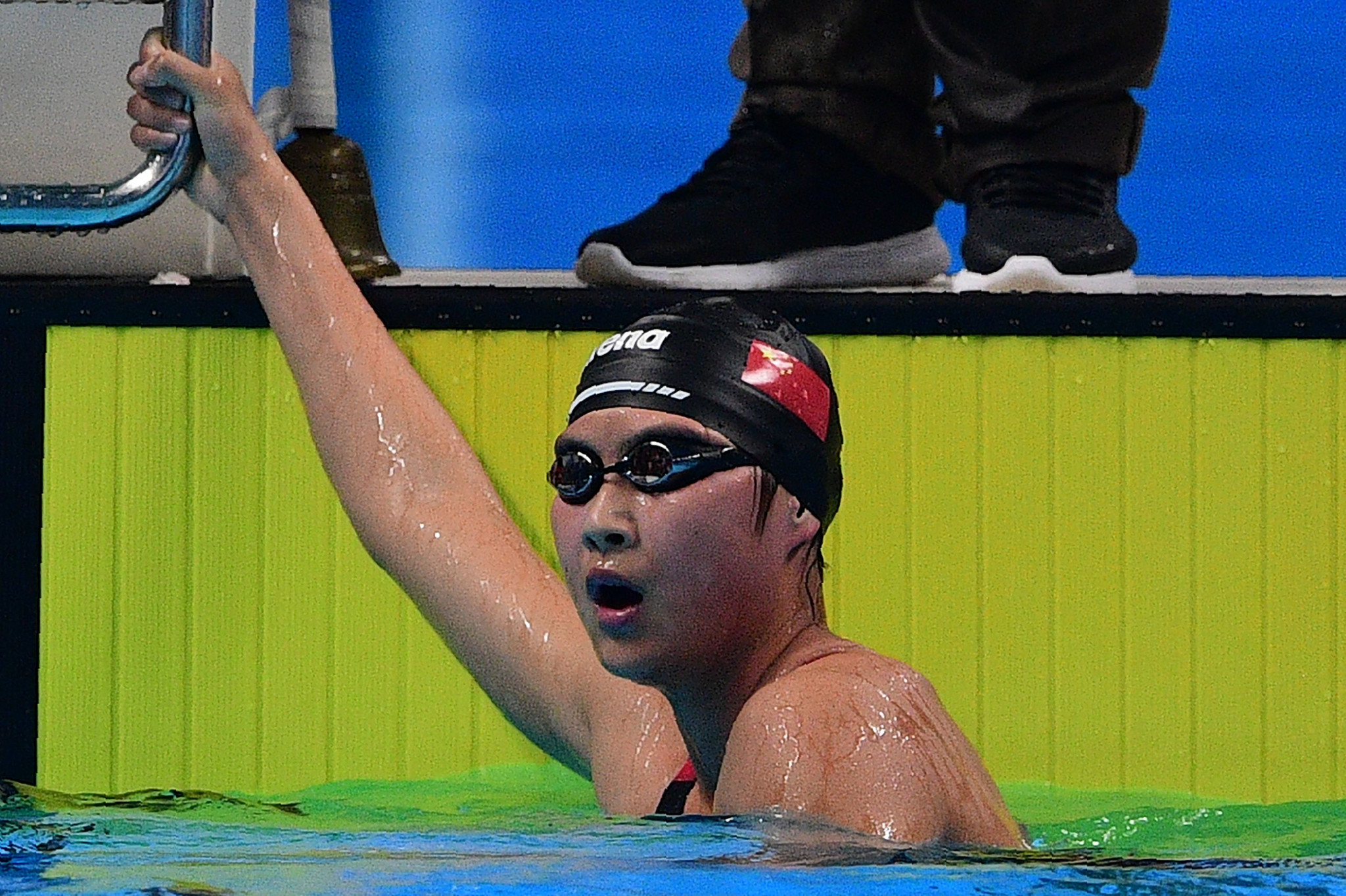 China's  Jianjiahe Wang, who is only 16, won the first gold medal of the night in the women's 1500 metres freestyle by just 0.12 seconds from team-mate Bingjie Li©Getty Images