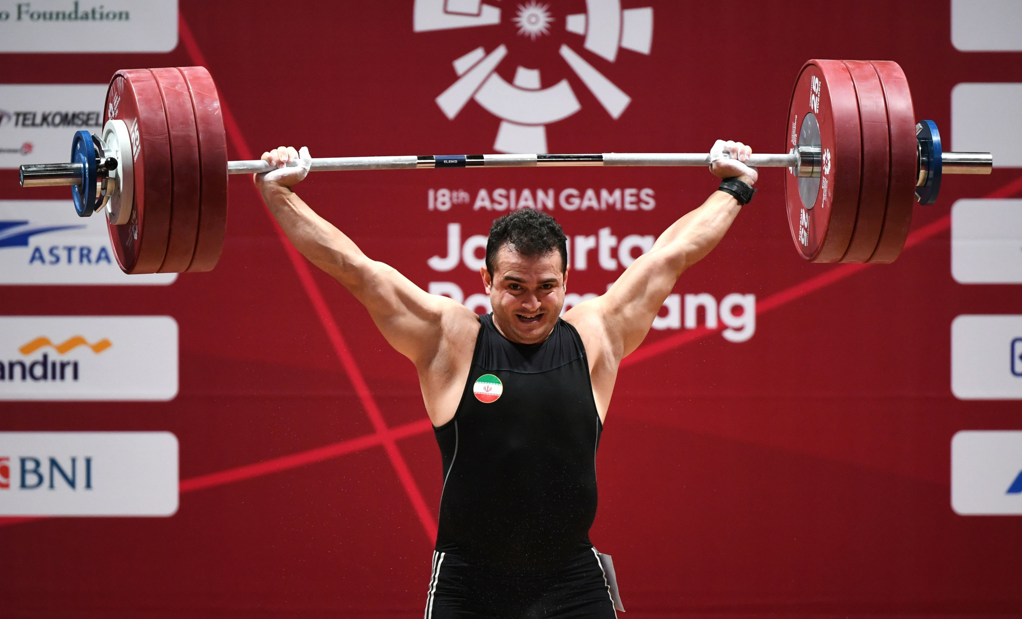 Iran's Sohrab Moradi broke a 19-year-old snatch world record on his way to winning the men's 94 kilograms weightlifting gold medal ©Getty Images
