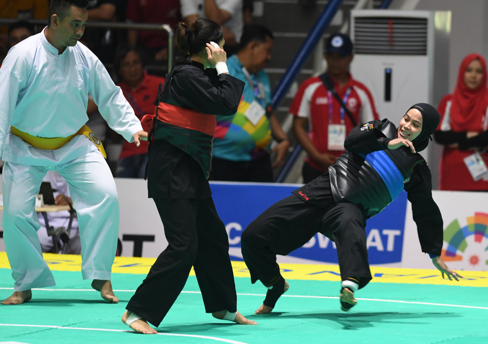 Sarah Tria Monita, blue, won one of Indonesia's incredible eight pencak silat golds today, in the women's class C 55-60kg final ©Getty Images