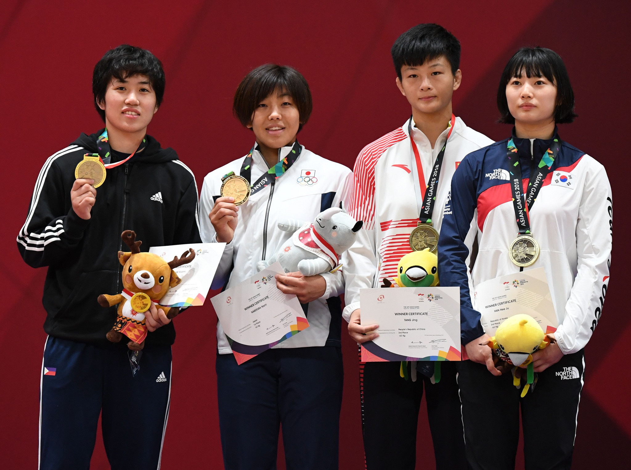 Nami Nabekura, second from left, was one of four judo gold medallists for Japan at the 2018 Asian Games today ©Getty Images
