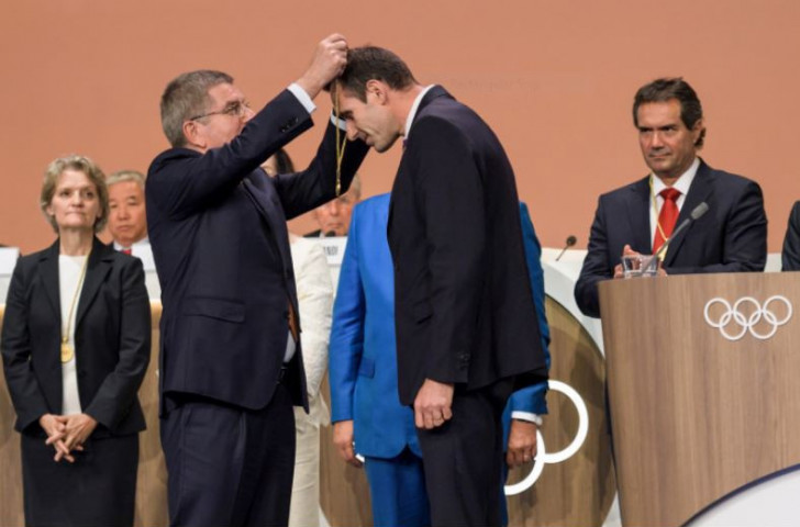 IOC President Thomas Bach conferring IOC membership upon FISA President Jean-Christophe Rolland last September ©Getty Images