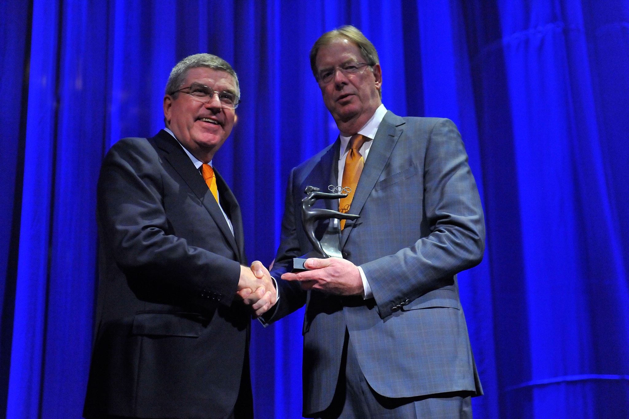 Larry Probst, right, with IOC President Thomas Bach ©Getty Images