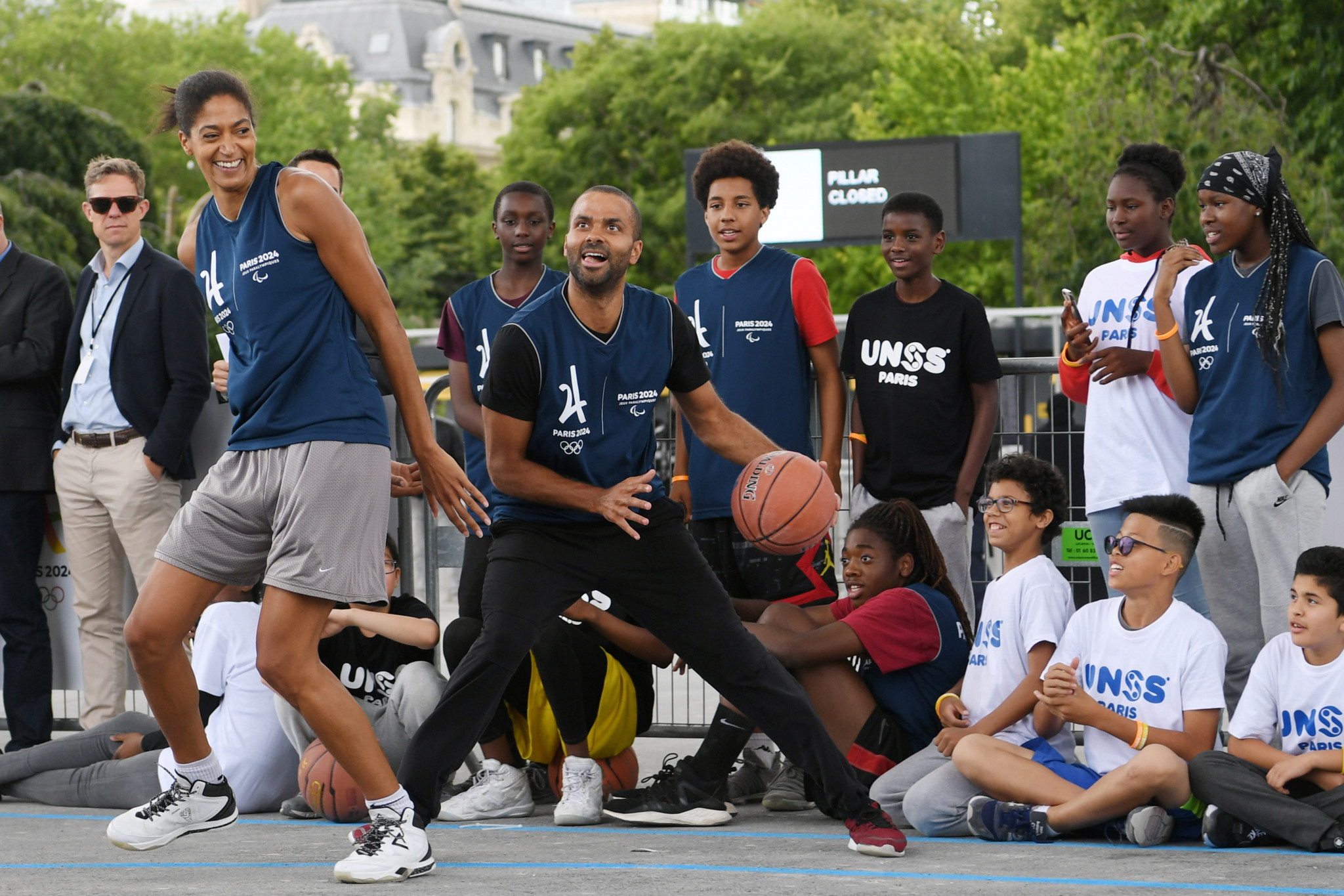 "French basketball player Tony Parker, centre, says it is his ""mission"" to promote sport among young people ©Paris 2024"